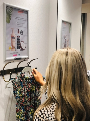 Advertise Your Brand with a Fitting Room Poster Campaign